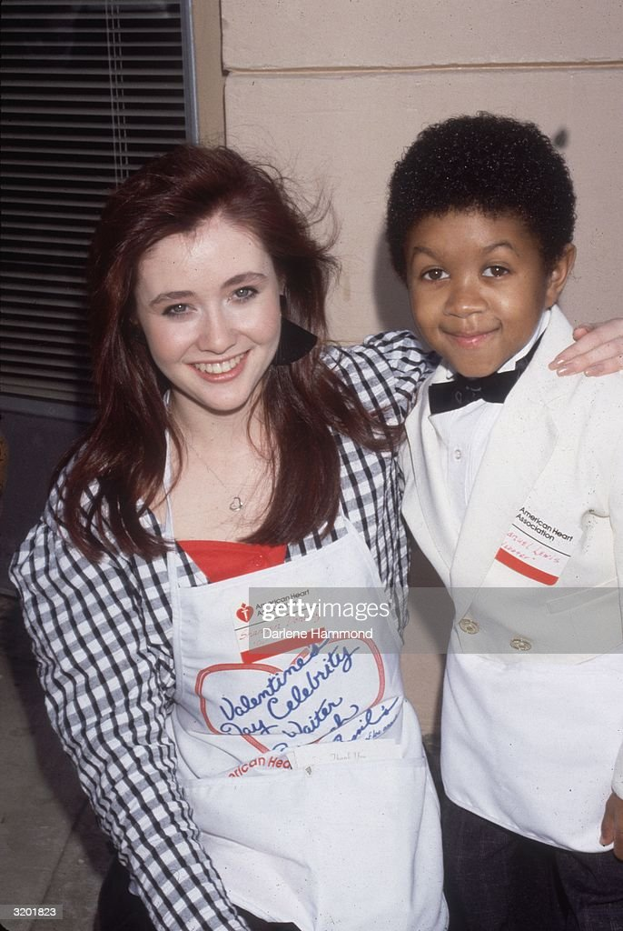 American actors <a gi-track='captionPersonalityLinkClicked' href=/galleries/search?phrase=Shannen+Doherty&family=editorial&specificpeople=208130 ng-click='$event.stopPropagation()'>Shannen Doherty</a> and Emmanuel Lewis smile for photographers at a Velentine's Day Celebrity Waiter brunch at Cyril's benefiting the American Heart Association.