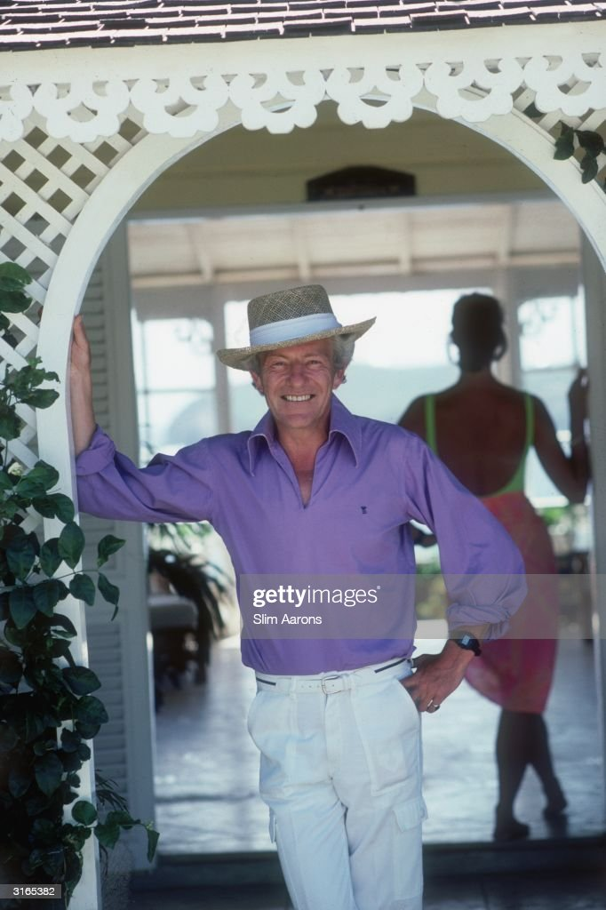 Photographer Patrick Lichfield looking relaxed in Mustique.