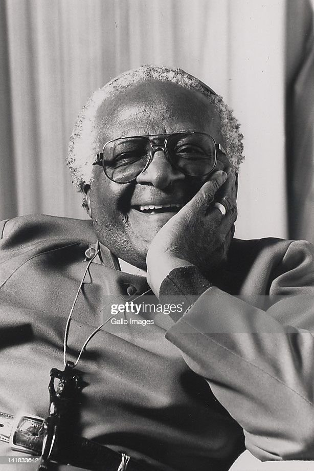 Archbishop Desmond Tutu laughing.