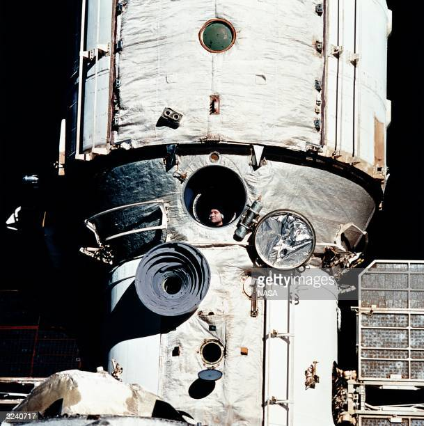 Cosmonaut Valery Polyakov appears at a window of the Russian space station Mir during the STS63 rendezvous with the American shuttle Discovery...