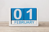 February 1st. Day 1 of month, calendar on white background. Winter time.