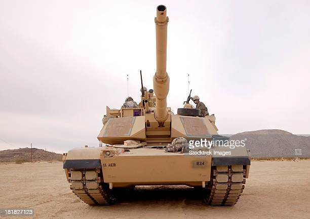 February 20, 2012 - U.S. soldiers perform maintenance on their M1 Abrams tank on Fort Irwin, California.