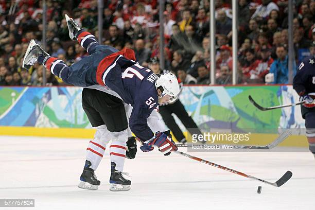 Switzerland's Mathias Seger throws a big check on USA's Bobby Ryan during a Men's Ice Hockey game between the United States and Switzerland held at...