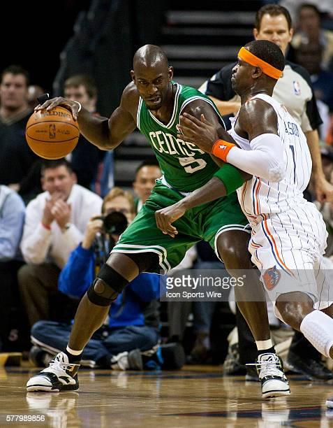 Boston Celtics power forward Kevin Garnett dribbles against Charlotte Bobcats shooting guard Stephen Jackson during an NBA basketball game at Time...