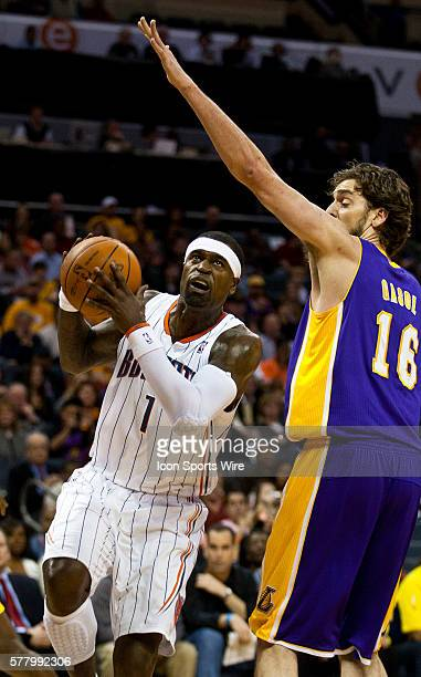 Charlotte Bobcats shooting guard Stephen Jackson drives against Los Angeles Lakers power forward Pau Gasol of Spain during an NBA basketball game at...