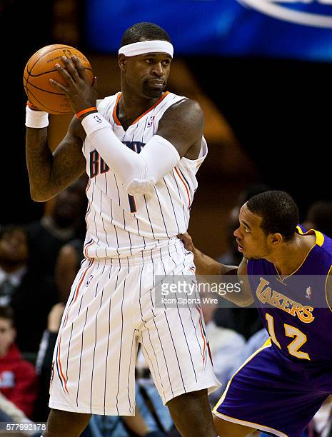 Charlotte Bobcats shooting guard Stephen Jackson looks to drive against Los Angeles Lakers point guard Shannon Brown during an NBA basketball game at...