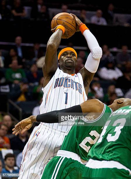 Charlotte Bobcats shooting guard Stephen Jackson works to shoot against the Boston Celtics during an NBA basketball game at Time Warner Cable Arena...