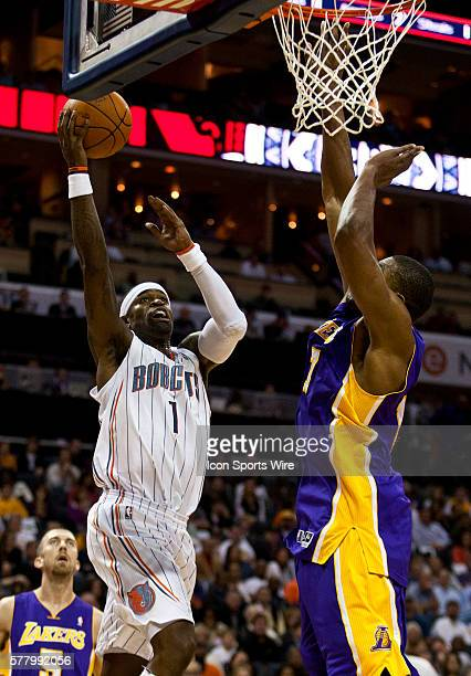 Charlotte Bobcats shooting guard Stephen Jackson works to drive against Los Angeles Lakers center Andrew Bynum during an NBA basketball game at Time...