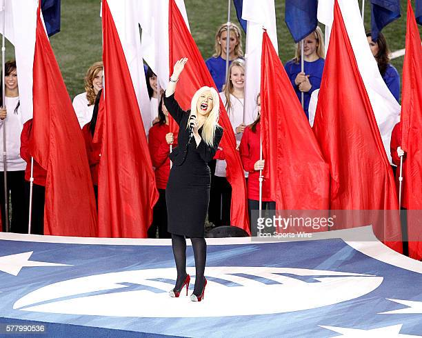 Christina Aguilera sings the National Anthem prior to the Pittsburgh Steelers game versus the Green Bay Packers in Super Bowl XLV at Cowboys Stadium...