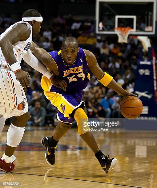 Los Angeles Lakers shooting guard Kobe Bryant drives against Charlotte Bobcats shooting guard Stephen Jackson during an NBA basketball game at Time...