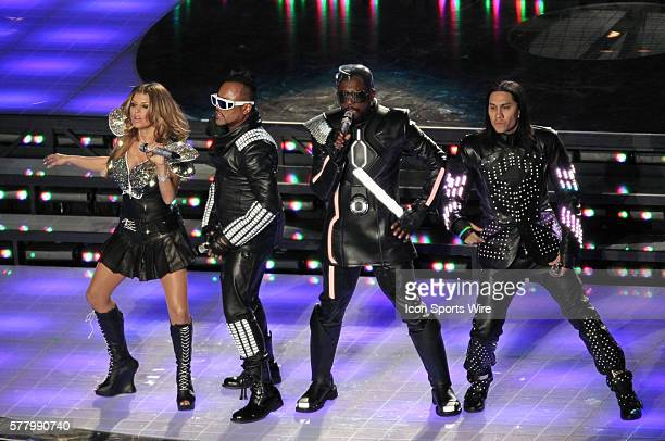 The Black Eyed Peas perform for the Halftime Show during the Pittsburgh Steelers game versus the Green Bay Packers in Super Bowl XLV at Cowboys...