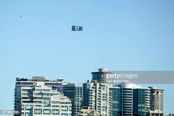 A plane flies over Seattle pulling a 12th man flag Seattle Seahawks players and 12th man fans celebrated bringing the Lombardi trophy home to Seattle...