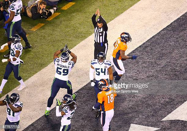 The referee signals a safety after a bad Denver snap in the first play of the game during Super Bowl XLVIII between the Denver Broncos and the...
