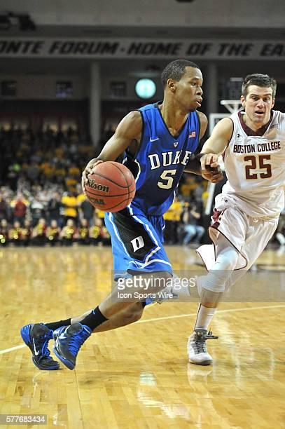 Duke Blue Devils forward Rodney Hood drives past Boston College Eagles guard Joe Rahon to the basket during the Duke Blue Devils game against the...