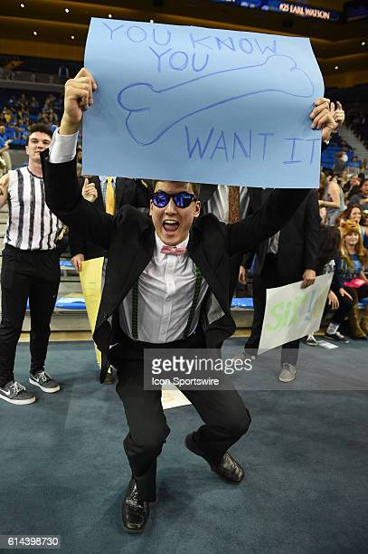 A UCLA student fan dressed up in business attire taunts the Huskies during an NCAA basketball game between the Washington Huskies and the UCLA Bruins...