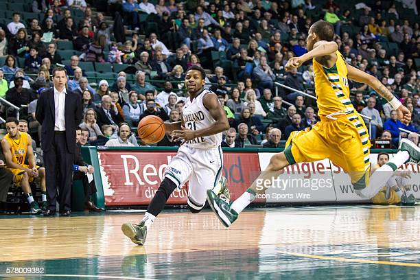 Cleveland State Vikings G Charlie Lee drives to the basket as Wright State Raiders G Joe Thomasson defends during the game between the Wright State...