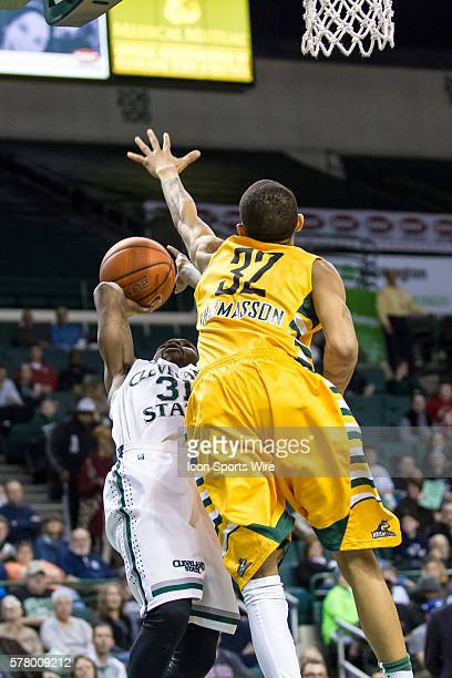 Cleveland State Vikings G Charlie Lee is fouled as he shoots by Wright State Raiders G Joe Thomasson during the game between the Wright State Raiders...