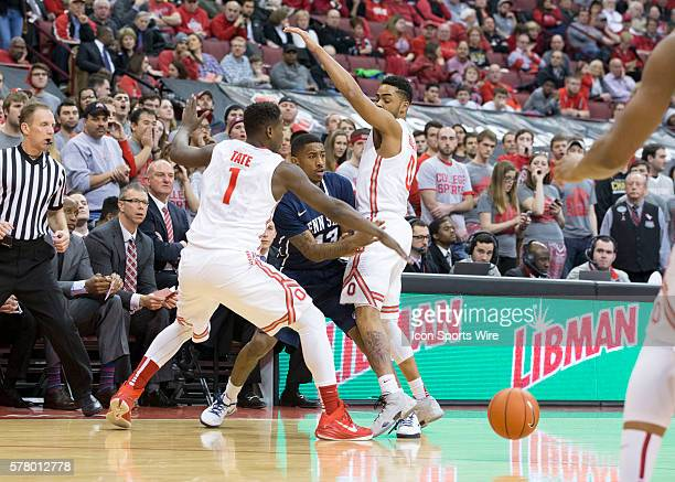 Geno Thorpe of the Penn State Nittany Lions pass the ball inbetween Jae'Sean Tate of the Ohio State Buckeyes and D'Angelo Russell of the Ohio State...