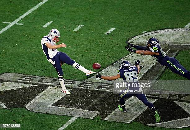 New England Patriots punter Ryan Allen punts under pressure from Seattle Seahawks wide receiver Doug Baldwin and outside linebacker Malcolm Smith...