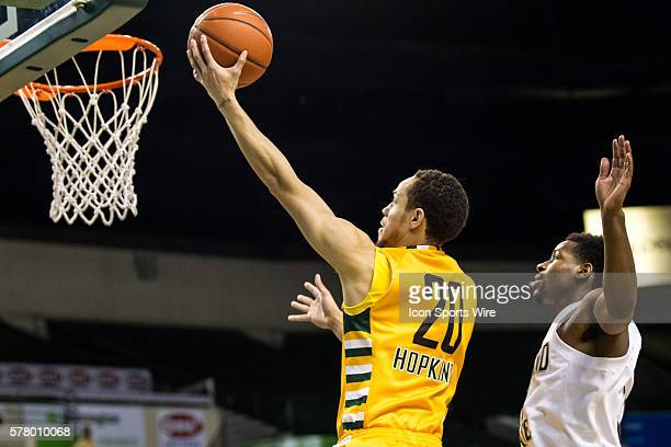 Wright State Raiders G Chrishawn Hopkins scores ahead of Cleveland State Vikings G Charlie Lee during the game between the Wright State Raiders and...