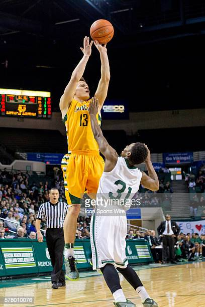 Wright State Raiders G Grant Benzinger shoots over Cleveland State Vikings G Charlie Lee during the game between the Wright State Raiders and...
