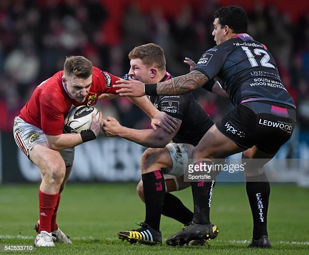 14 February 2016 Rory Scannell Munster is tackled by Sam Underhill and Josh Matavesi Ospreys Guinness PRO12 Round 14 Munster v Ospreys Irish...