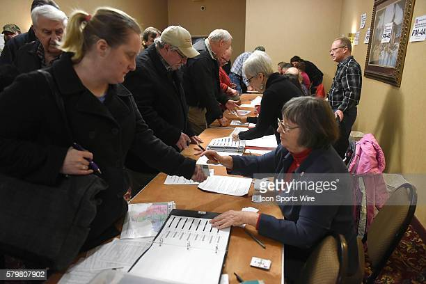 Volunteers check the party registration of the more than 450 persons attending a local Republican Party caucus as part of the Iowa Caucus in Fort...