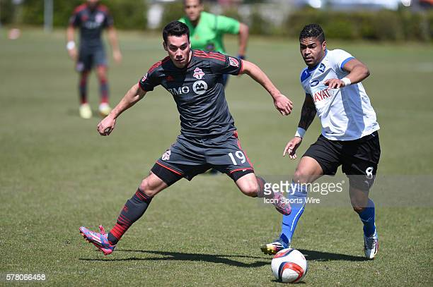 Toronto FC's Daniel Lovitz and HB Koge's Bruninho go after the ball during first half action between Toronto FC and HB Koge at the IMG Academy Field...