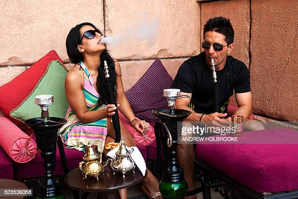 February 22 2012 American tourists staying at the 5 star Atlantis Hotel Dubai on Palm Jumeirah smoke a hookah