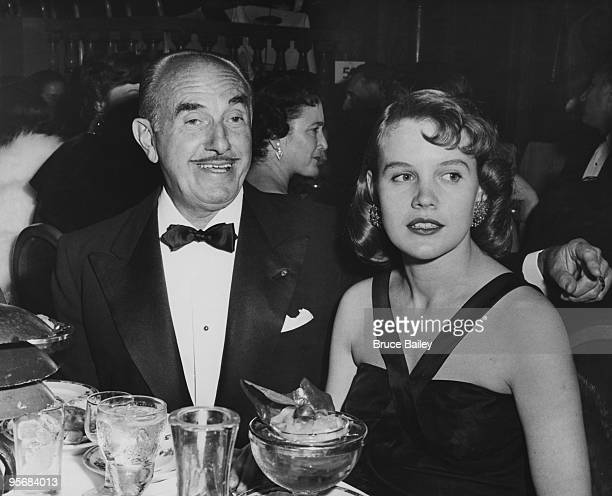 American film producer Jack Warner with actress Carroll Baker at the Hollywood Foreign Press Association Awards 1956 Baker was nominated in the...