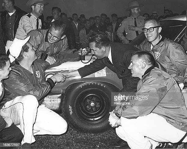 """DeWayne """"Tiny"""" Lund is congratulated in victory lane at Daytona International Speedway after winning the Daytona 500 NASCAR Cup race"""