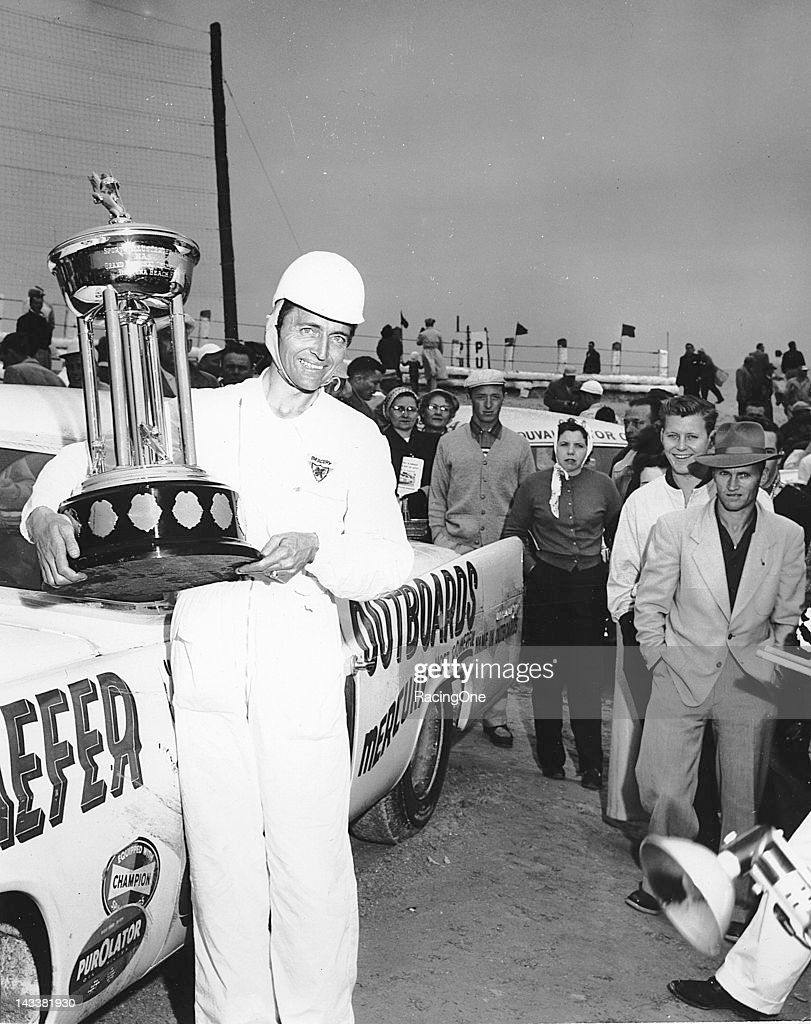 Tim Flock with his trophy after winning the NASCAR Cup race on the Daytona BeachRoad Course Flock was driving one of the powerful Chrysler 300s owned...