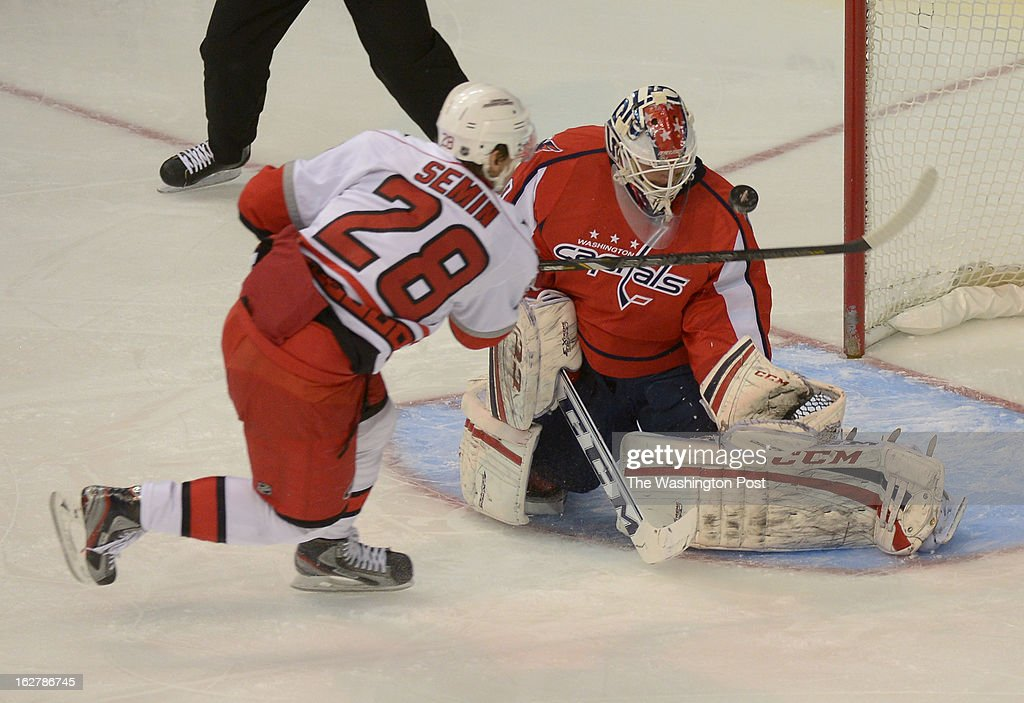 Washington Capitals goalie Braden Holtby (70) makes a save on a shot by Carolina Hurricanes left wing Alexander Semin (28) during 1st period action on February 26, 2013 in Washington, DC
