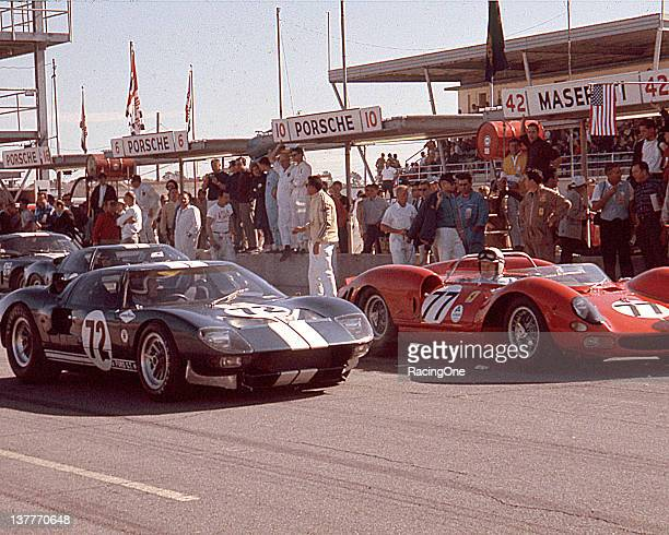 Just before the start of the Daytona Continental at Daytona International Speedway John Surtees fast qualifier for the race in a Ferrari 330 P2 owned...