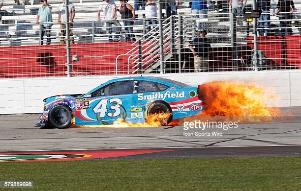 Aric Almirola guides his burning car down the front stretch late in the Folds of Honor Quiktrip 500 NASCAR Sprint Cup series race at the Atlanta...