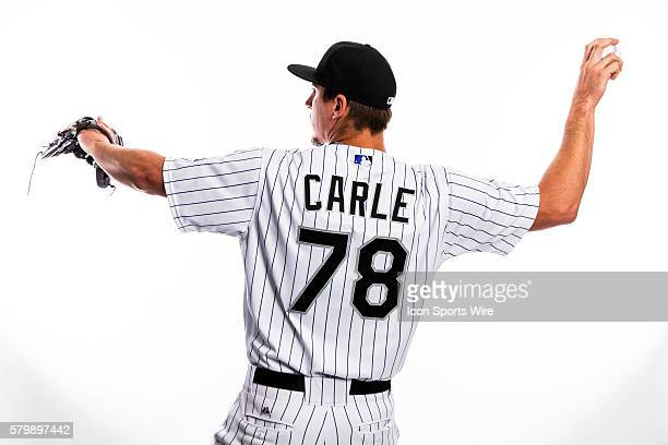 Pitcher Shane Carle poses for a portrait during the Colorado Rockies photo day in Scottsdale Ariz