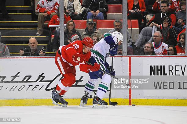 February 3 2014 Detroit MI Detroit Red Wings center Joakim Andersson battles with Vancouver Canucks defenseman Jason Garrison for the puck along the...