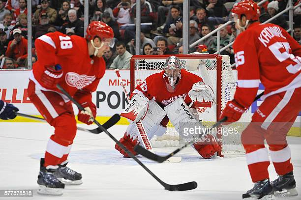February 3 2014 Detroit MI Detroit Red Wings goalie Jimmy Howard sets up as Detroit Red Wings center Joakim Andersson takes the loose puck during the...