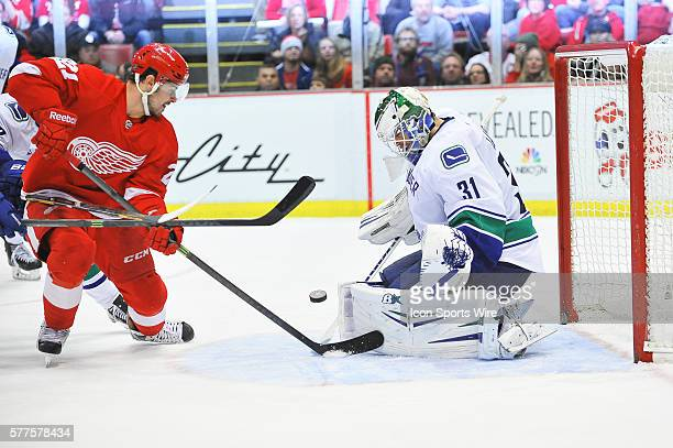 February 3 2014 Detroit MI Detroit Red Wings left wing Tomas Tatar can't put this point blank shot past Vancouver Canucks goalie Eddie Lack during...