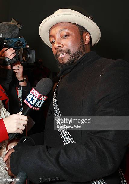 Will I Am of the Black Eyed Peas walks the red carpet before the David Gueta and Black Eyed Peas Pre Super Bowl XLV party at the Tower Building in...