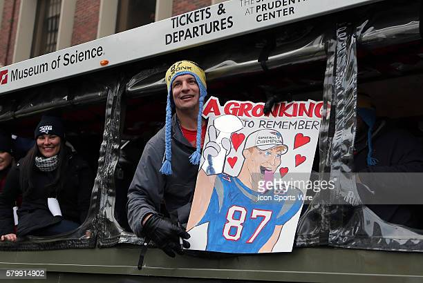 Rob Gronkowski poses with a sign a fan made poking fun at the story