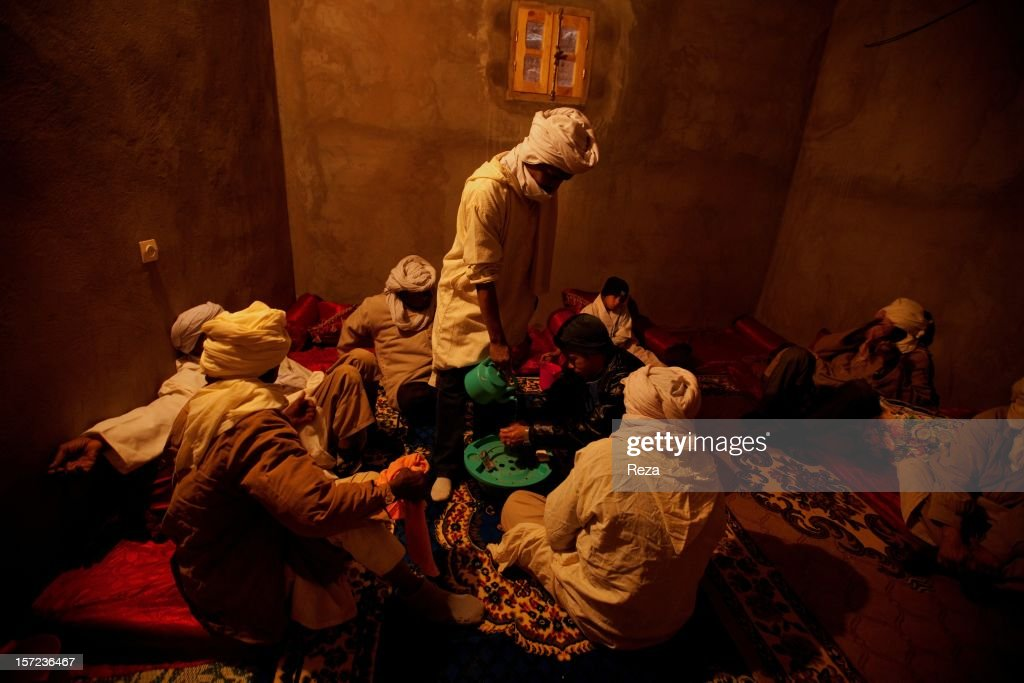 February 5th, 2012, Village of Sidi, Algeria. In the region of Timimoun, on the anniversary of the birth of Prophet Mohammed, tradition invites that whoever is able to, should offer a meal to passers-by. In Sidi Ali, pilgrims Wash their hands before sharing their meal.