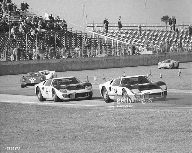 Action during the 24 Hour Daytona Continental at Daytona International Speedway has the eventual winning Shelby American Ford MK II of Ken Miles and...