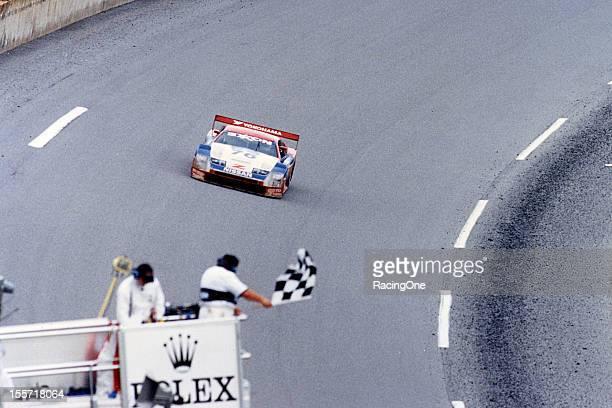 The checkered flag falls at Daytona International Speedway as the Nissan 300ZX of Scott Pruett Butch Leitzinger Paul Gentilozzi and Steve Millen...