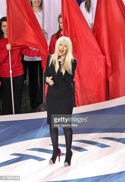 Christina Aguilera performs during the national anthem during the Green Bay Packers victory over the Pittsburgh Steelers by the score of 3125 in...