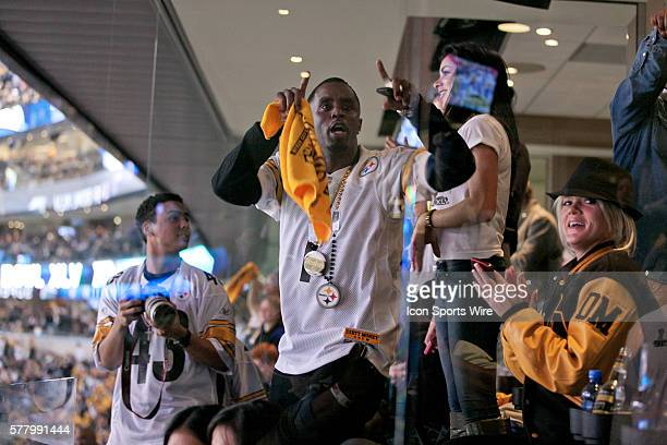 Rap artist and producer Sean Combs or P Diddy celebrates during the Green Bay Packers victory over the Pittsburgh Steelers by the score of 3125 in...