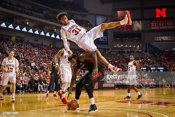 Nebraska Cornhuskers forward Shavon Shields his legs taken out from under him by Rutgers Scarlet Knights forward DJ Foreman and lands on his should...