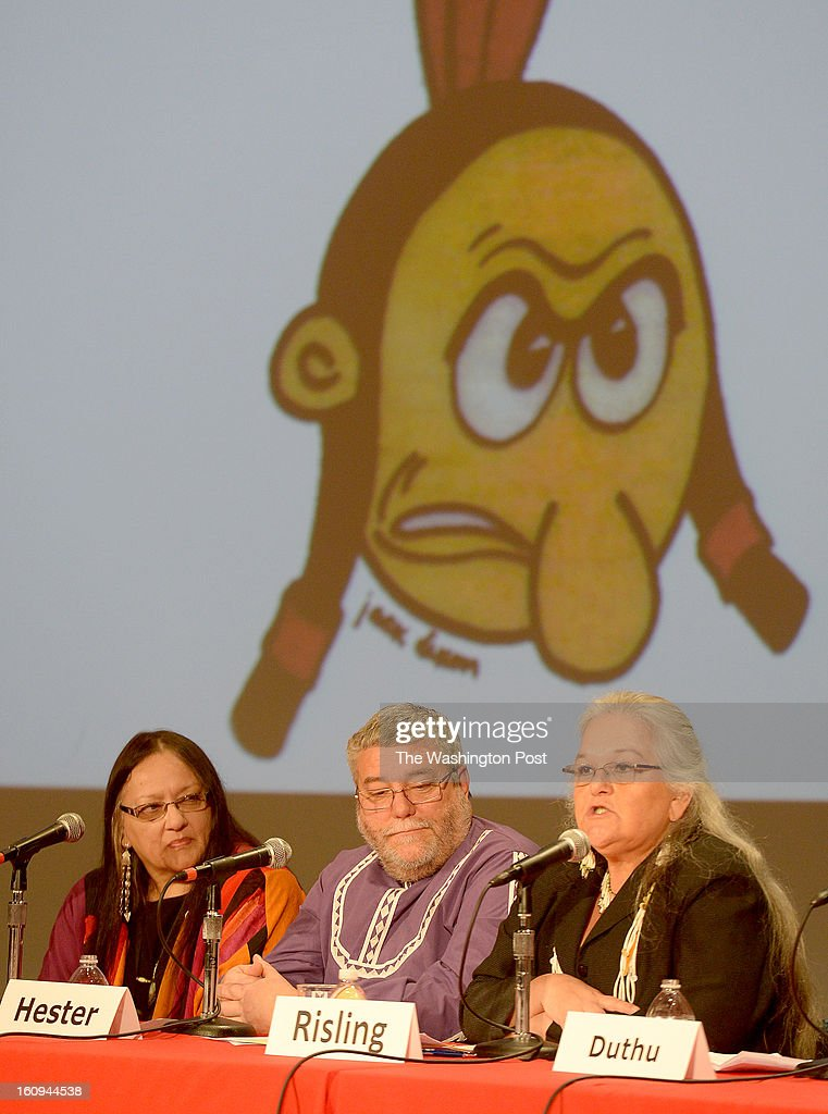 Ms. Lois Risling (R) an educator, land specialist for the Hoopa Valley tribes, projects on a screen the former mascot used by Stanford University, where she was a student, along with other panelists moderator Dr. Suzan Shown Harjo (L) and Dr. Lee Hester associate professor and director of American Indian Studies, The University of Oklahoma during the symposium on racist Native American images, stereotypes and team names, including the Washington Redskins on February 7, 2013 in Washington, DC