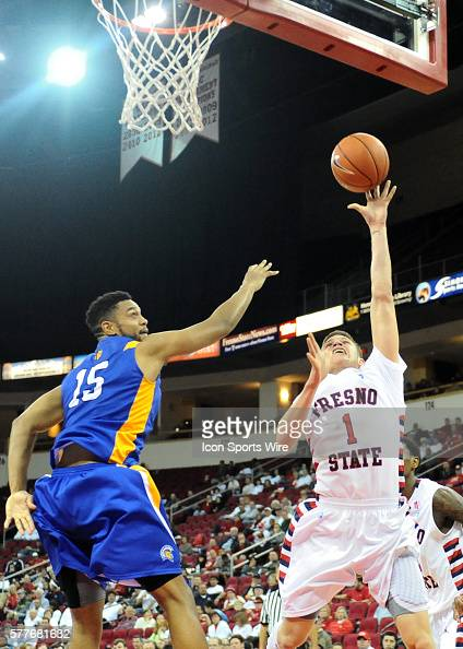 Fresno State Bulldogs Guard Tyler Johnson goes to the hoop as San Jose State Spartans Forward Chris Cunningham attempts to block his shot during the...