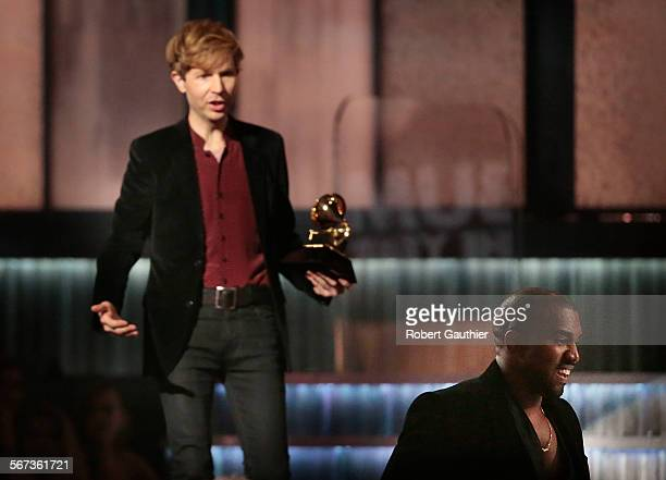 LOS ANGELES CA February 8 2015 Kanye West right avoids contact with an inviting Beck after Beck won Album of the Year at the 57th Annual GRAMMY...